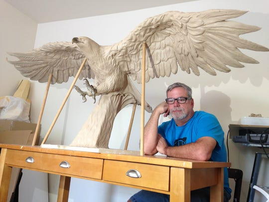 Local art teacher Randy New is sculpting the pieces for the Navarre Black Hawk Memorial, which is expected to be unveiled in March 2016. The memorial in Navarre Park will honor the 11 servicemen killed in a helicopter crash in March, along with all lives lost in military service.