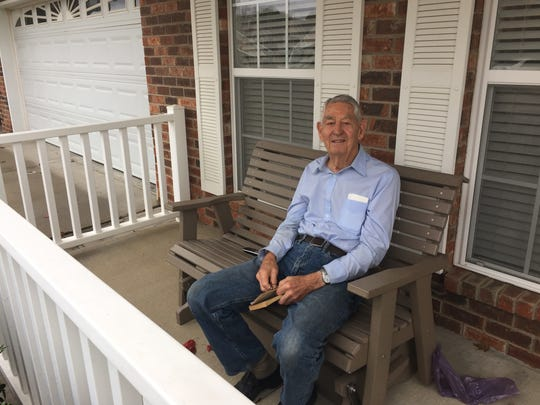 Fred stroop, 87, sits on his porch nearly every day the weather permits and reads - often it's one of his Louis L'Amour books from his full set of the author.
