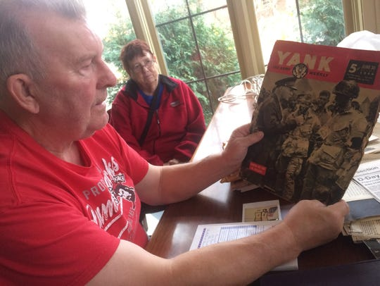 Historian and author Drew Dodds shows a copy of Yank
