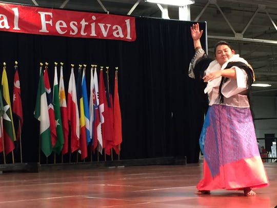 Maria Manalang, of the Mabuhay Philippine Cultural Community, performs a dance at the Indy International Festival, Saturday, Nov. 7, 2015.
