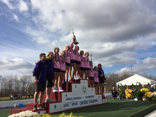The Lexington girls hoist the gold trophy after winning