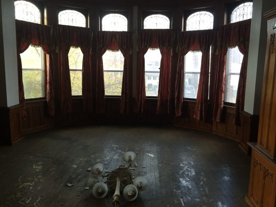 A broken chandelier lays on the floor of an ornate room inside the Sisters of the Holy Nativity Convent in Fond du Lac. Owner George Pan-Andreas said he wants to refurbish the fire-damaged landmark.