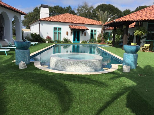 The Mitchell family's pool is all 'California Dreamin' with hues of turquoise and sky blue in a picture perfect setting.