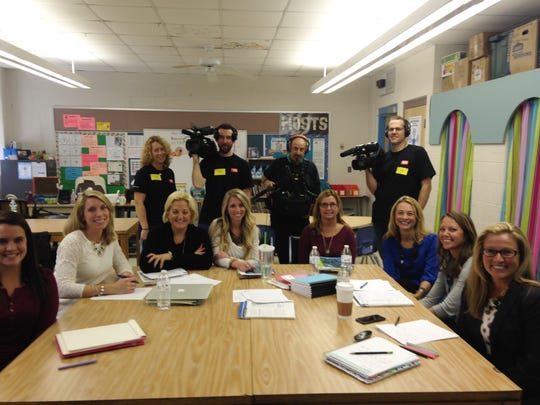Teachers and Kristin Gray, right, pose with the camera crew from the Teaching Channel.
