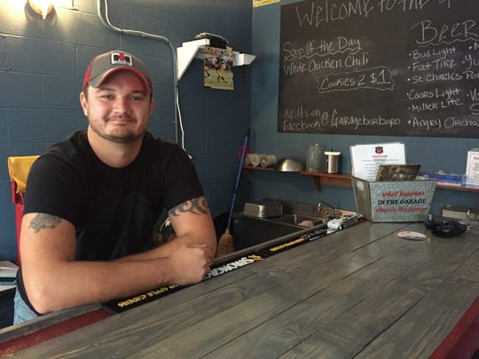 Chris Gamlin stands behind the counter at his newly opened Garage Bar and Sandwich Shop, 405 Front St. in downtown Murfreesboro.
