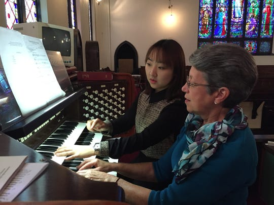 Church organist Peggy Wolverton and Ji Hye Choi perform a duet.