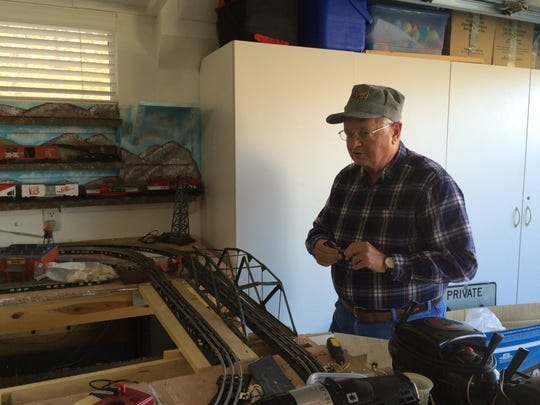 Victor Lorch of St. George works on his O-scale model railroad in preparation for this weekend's Color Country Model Railroad tour.