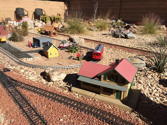 A G-scale model train run by Tom and Amy Meyers is part of the Color Country Model Railroad tour.