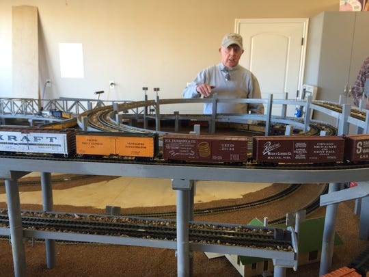 Charles Job demonstrates his HO model railroad in preparation for the Color Country Model Railroad tour this weekend.