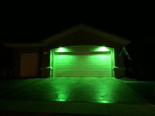 A home in Sun City Palm Desert  pays tributes to veterans as part of the nationwide Greenlight A Vet  campaign. Nov. 9, 2015.