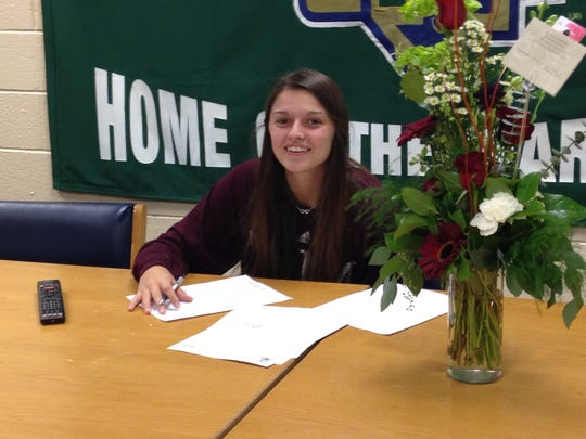 Alexsa Parker signs her National Letter of Intent to play volleyball for New Mexico State University.
