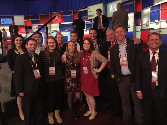 Ripon College President Zach Messitte, students and faculty pose for a photo at the Republican debate Tuesday in Milwaukee.