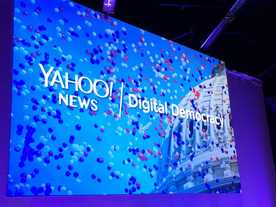 A screen shows the logo for Yahoo News' Digital Democracy
