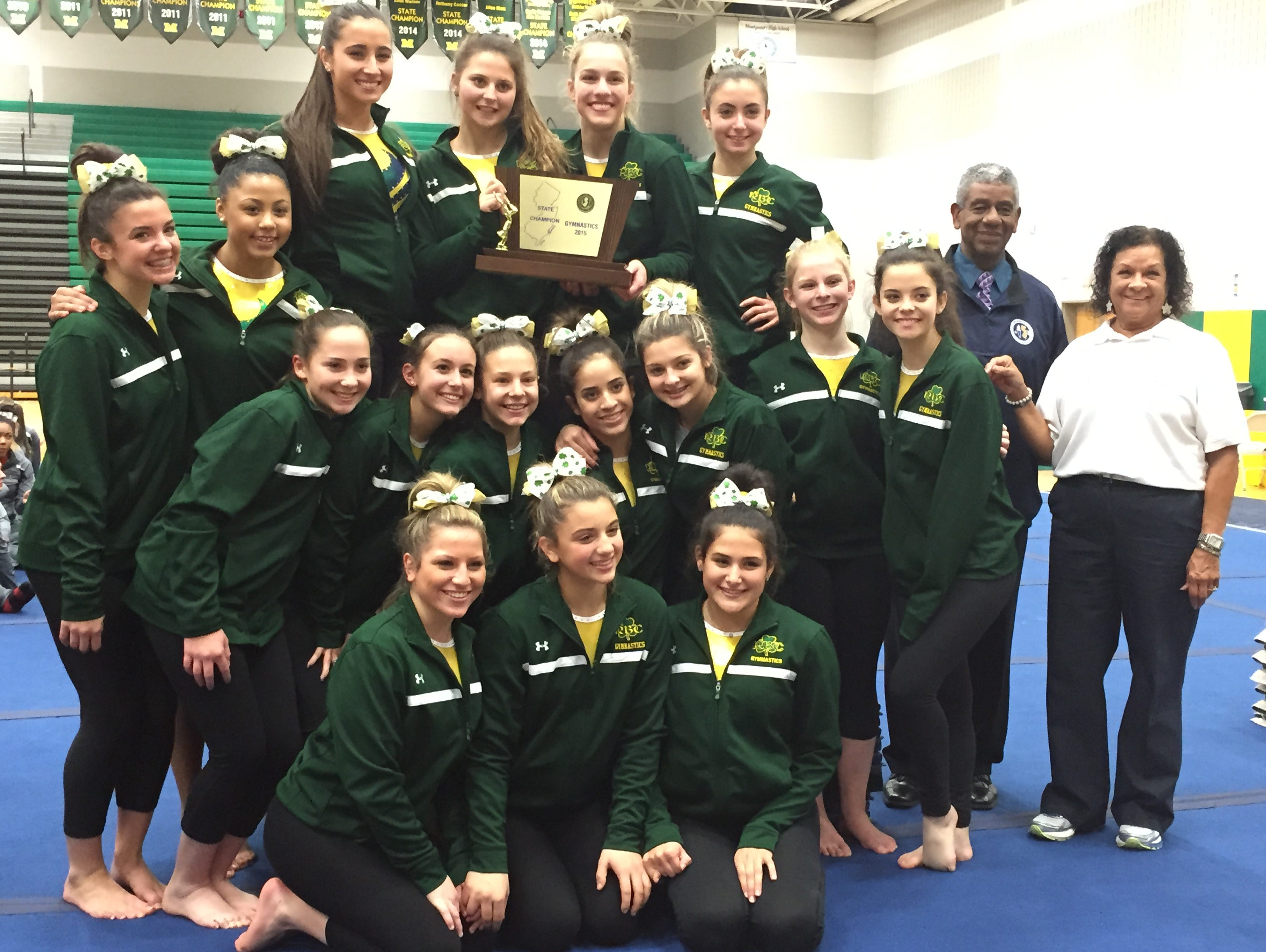 Red Bank Catholic poses with the NJSIAA gymnastics team trophy.