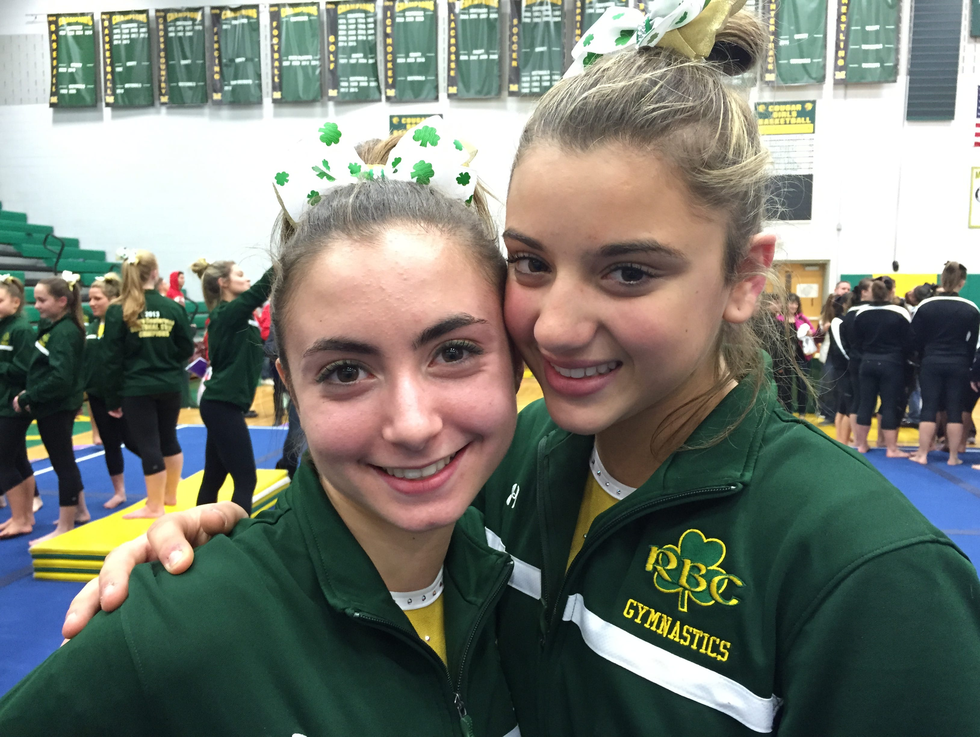 Red Bank Catholic's Nicolette DiPrisco (left) and Ally Cucich are all smiles after their team's state gymnastics title.
