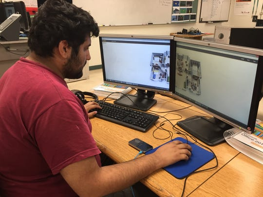 In this 2016 file photo, an EPISD Center for Career and Technology Education student works on an assignment in a telecommunications class.