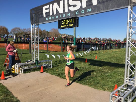 Wilson Memorial's Natalie Prye cruises past the finish