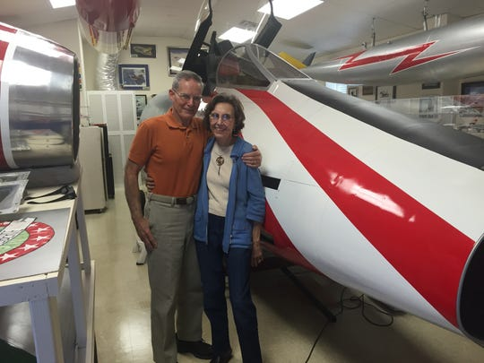 Pete and Anne Rob stand in front of a life-size airplane
