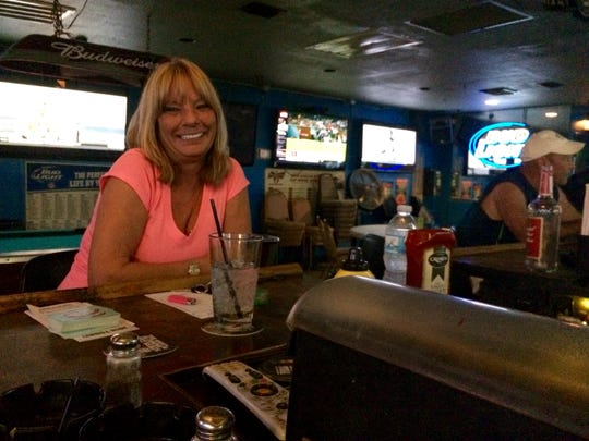"Self-proclaimed ""general manager"" Christine Davis sits  at her perch at the corner of the bar at The O Bar in Cape Coral. She and husband Cliff Davis took over The O Bar in 2008."