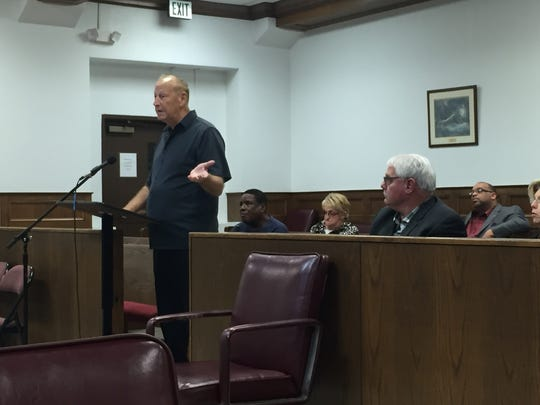 James Poe speaks in favor of passing a garbage collection