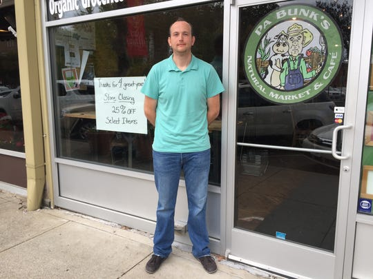 Pa Bunk's Natural Market and Cafe owner Corey Williams stands in front of his business on the Public Square Monday morning, just hours after letting the community know he will be closing the doors at the end of the year.