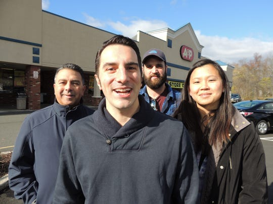 Back in 2015, Joe Agovino, center, led an unsuccessful grassroots effort to persuade Trader Joe's to take over the former A&P site in Valley Cottage. Agovino's allies in the effort were, from left: Rockland County legislator Rich Diaz of Congers, Benjamin Towers, and Agovino's wife, Julianne. They were photographed at the A&P site on Route 303 in Valley Cottage on Nov. 14, 2015. Photo by Peter D. Kramer/The Journal News.