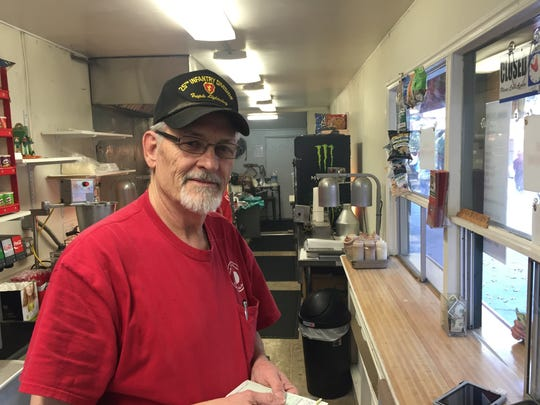 Andy Crane of Andy's Mini-Donuts & Dog House at the Oak Tree Village at Oak Glen.