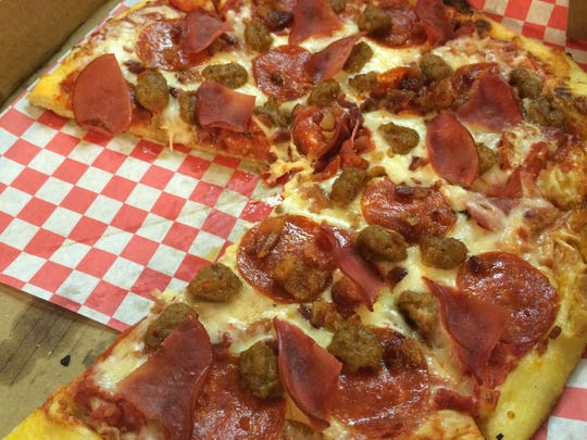 The Carnivore, Riggatti's meat-covered pizza is just one tasty way to enjoy this wood fired pizza.