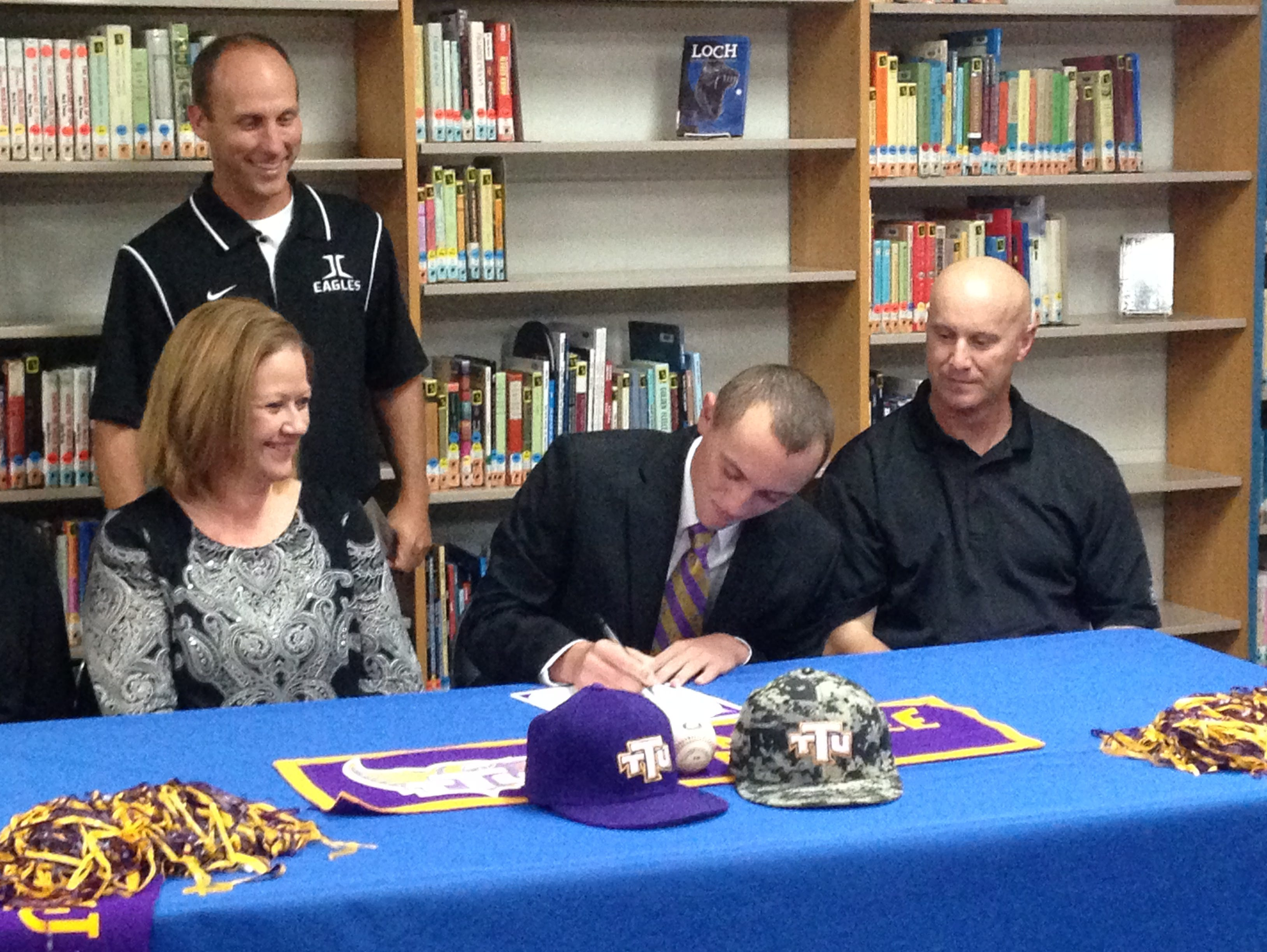 Jackson Christian senior Hunter Higdon signs his letter of intent Tuesday to play baseball at Tennessee Tech.