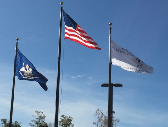 The Tunica-Biloxi tribal flag (right) flies beside