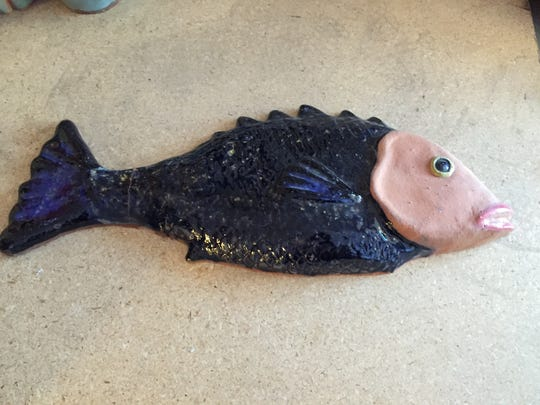 A ceramic fish that fell off the shelf at Tlalli Arts studio, Palm Springs on Nov. 6, 2015 broke at the tail, but will survive.