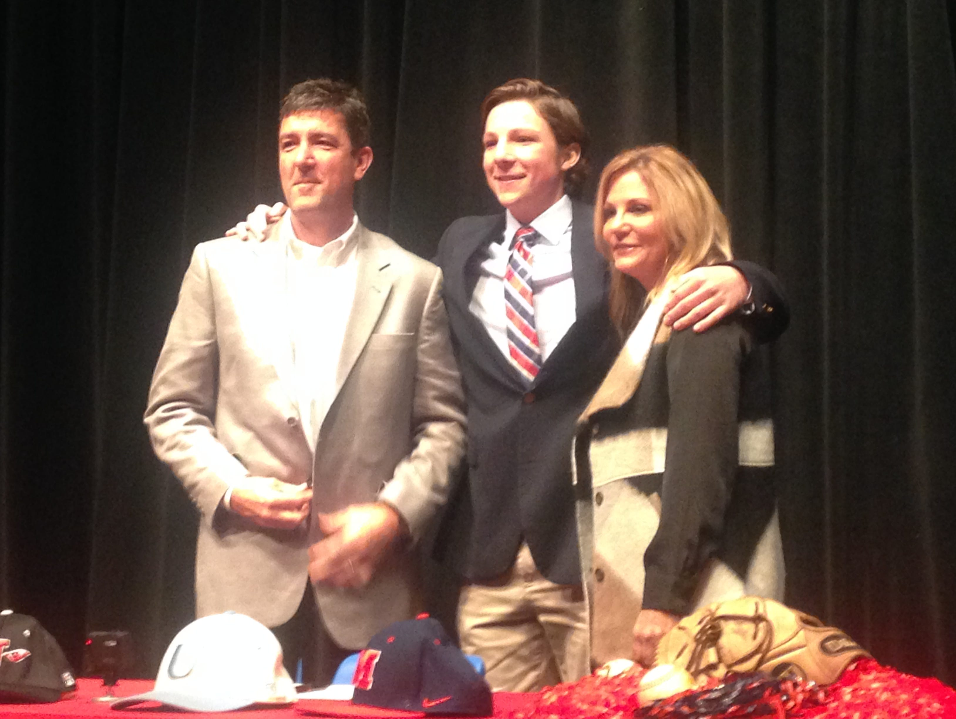 USJ senior Ryan Rolison poses with his parents Wednesday. He signed to play baseball at Ole Miss.
