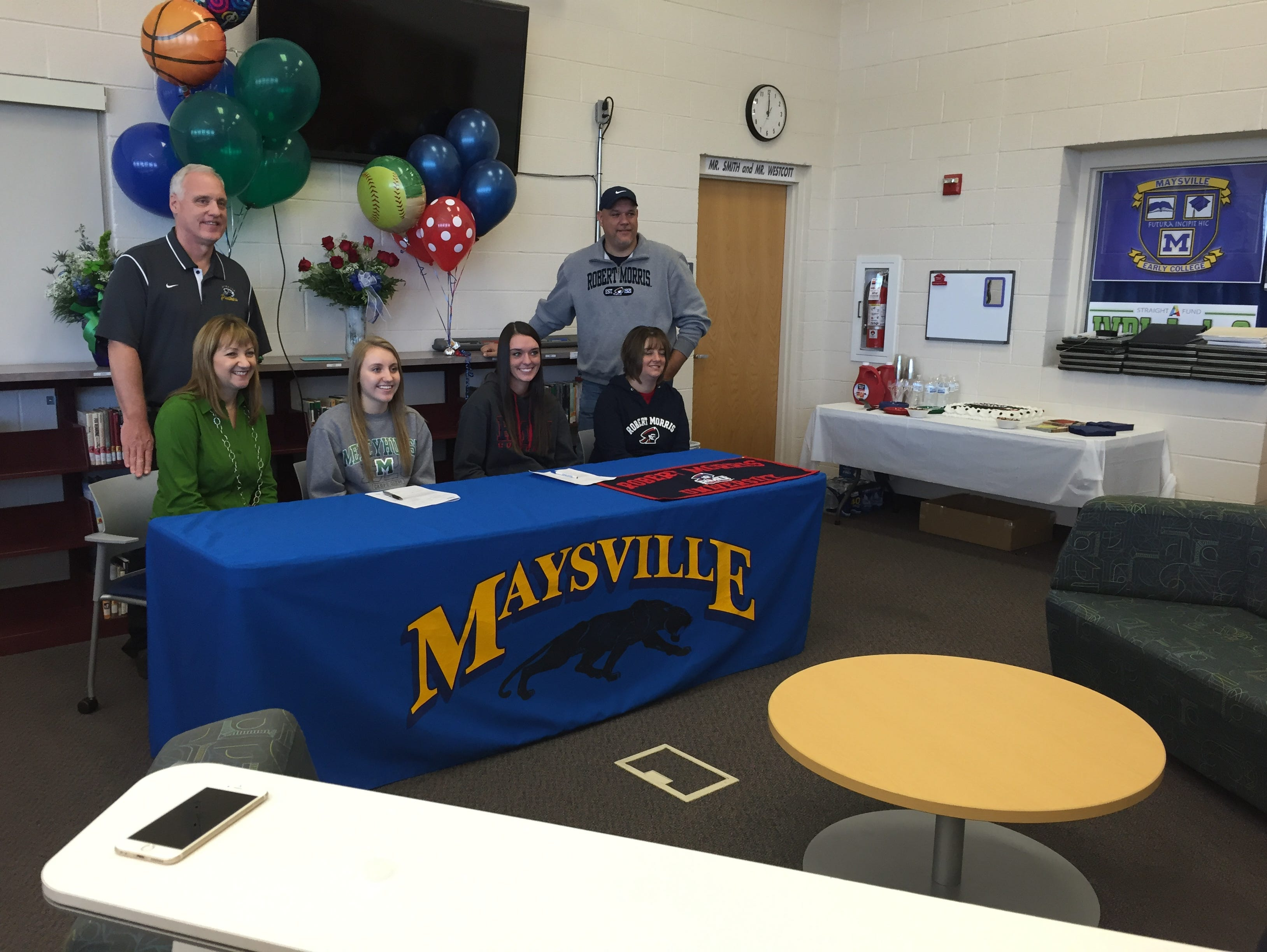 Maysville seniors Kori Sidwell and Madison Riggle signed their letters of intent Thursday at the high school. Pictured are (from top left: Lou Sidwell, Terri Sidwell, Kori Sidwell, Madison Riggle, Melissa Riggle and Kyle Riggle.
