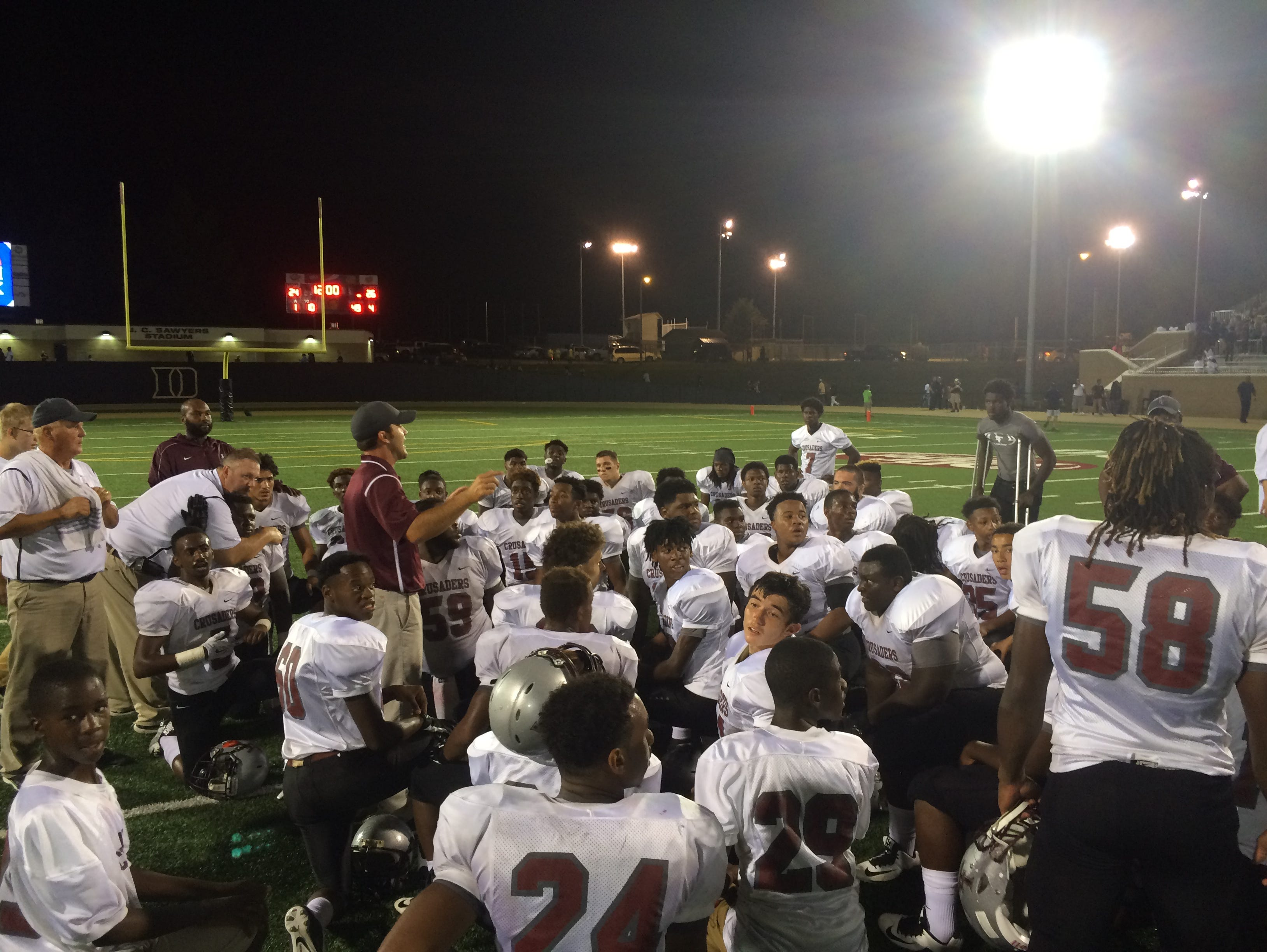 Liberty head coach Tyler Turner speaks to his team after a game earlier this year.