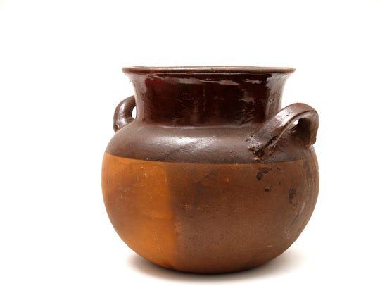 An olla is a pot, especially an earthen pot, for holding