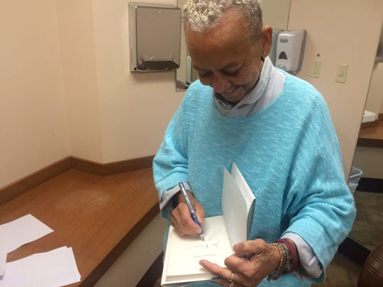 Nikki Giovanni signs books in Indianapolis in November