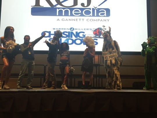 """The """"Chasing Shadows"""" screening had a costume contest. Brock Stearns (second from right) won a pair of skis with his costume."""