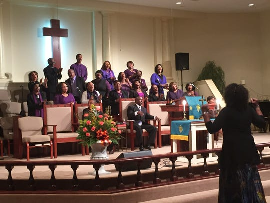 The choir from New Hope CME Church sing at the 130th anniversary celebration for St. Paul Christian Methodist Episcopal Church.
