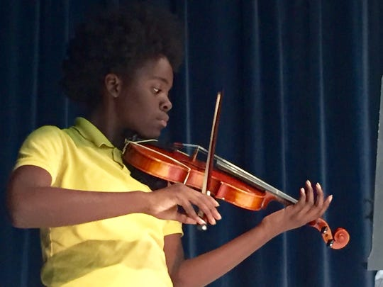 """""""String Stars,"""" students from Apalachee Tapestry Magnet School of the Arts, perform during a family engagement event Monday night."""