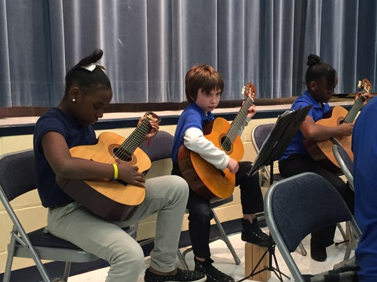"""Star Strummers,"" students from Apalachee Tapestry Magnet School of the Arts, perform during a family engagement event."