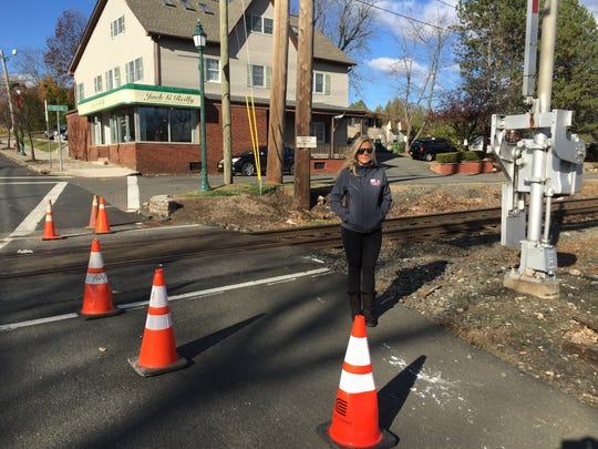 Congers resident Vanessa Reiser on Monday said new safety measures, such as better lighting, are needed at the Lake Road rail crossing. North Rockland Avenue is behind her.