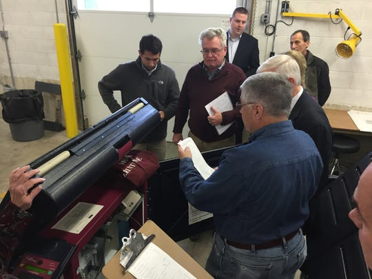 John Sette of the Morris County Board of Elections examines a paper readout of vote totals from a Morristown Ward Four voting machine during an election recount Tuesday at the Morris county voting machine warehouse in Hanover.