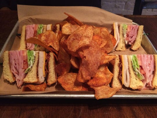 Turkey club with homemade barbecue chips at Doc Crow's in Louisville.