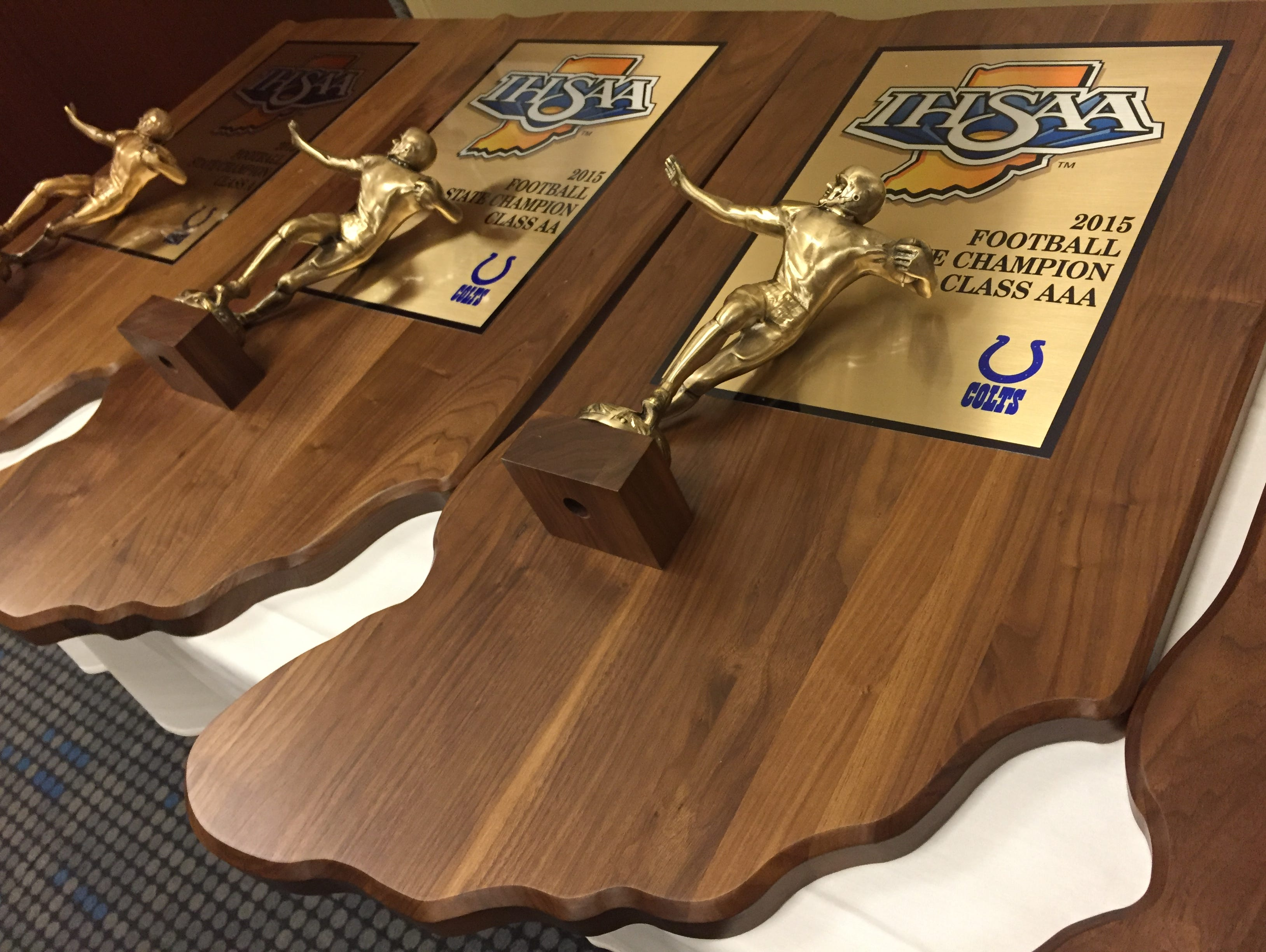 The state championship trophies on display at Lucas Oil Stadium on Monday.