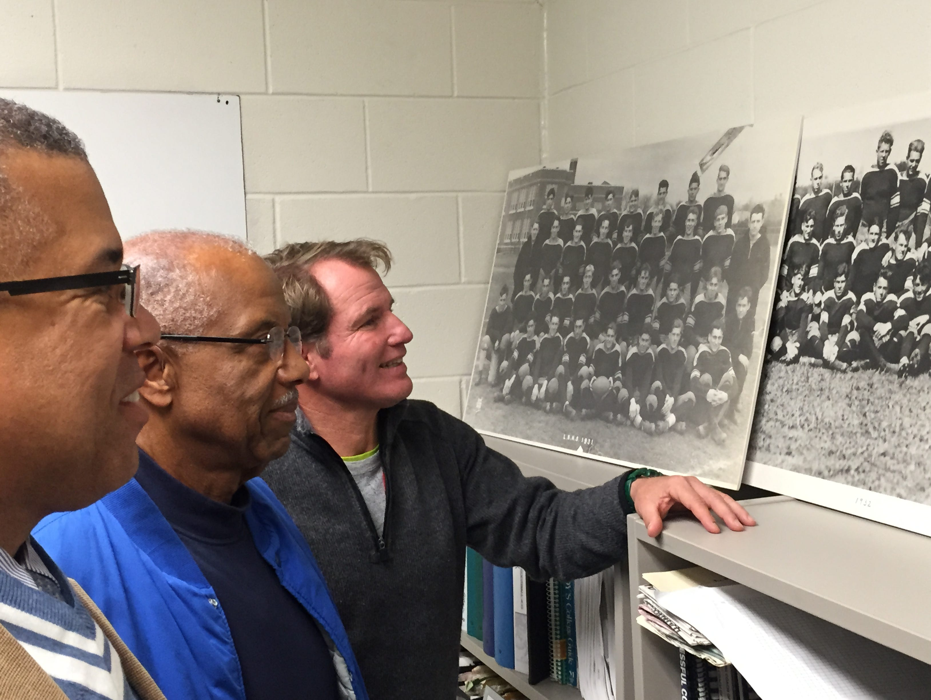 Wesley Mayo Jr. (left), Wesley Mayo Sr. (center) and Long Branch football coach Dan George (right) all played football for the Green Wave, and all played against Red Bank on Thanksgiving Day, with the two teams set to play for the 93rd time.