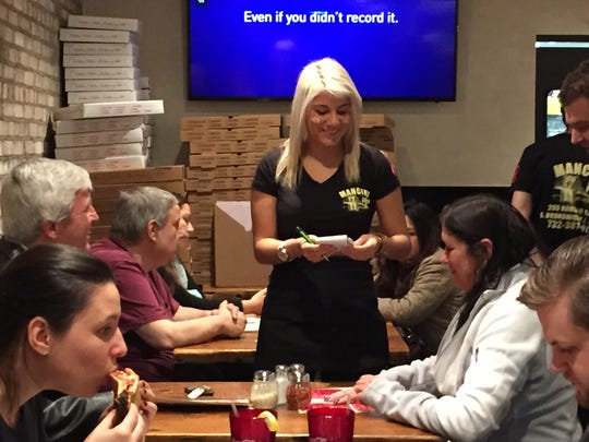 """American Idol"" Jax was hired for the night at Mancini Pizza, one of her favorite places. After a fire closed the popular East Brunswick restaurant in May, Mancini Pizza reopened Wednesday to record crowds."