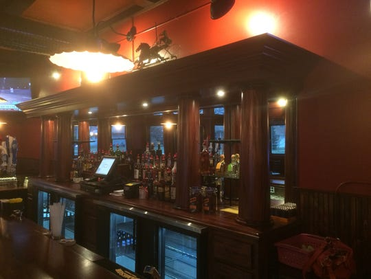 Inside the remodeled Jockey Club, the bar has been