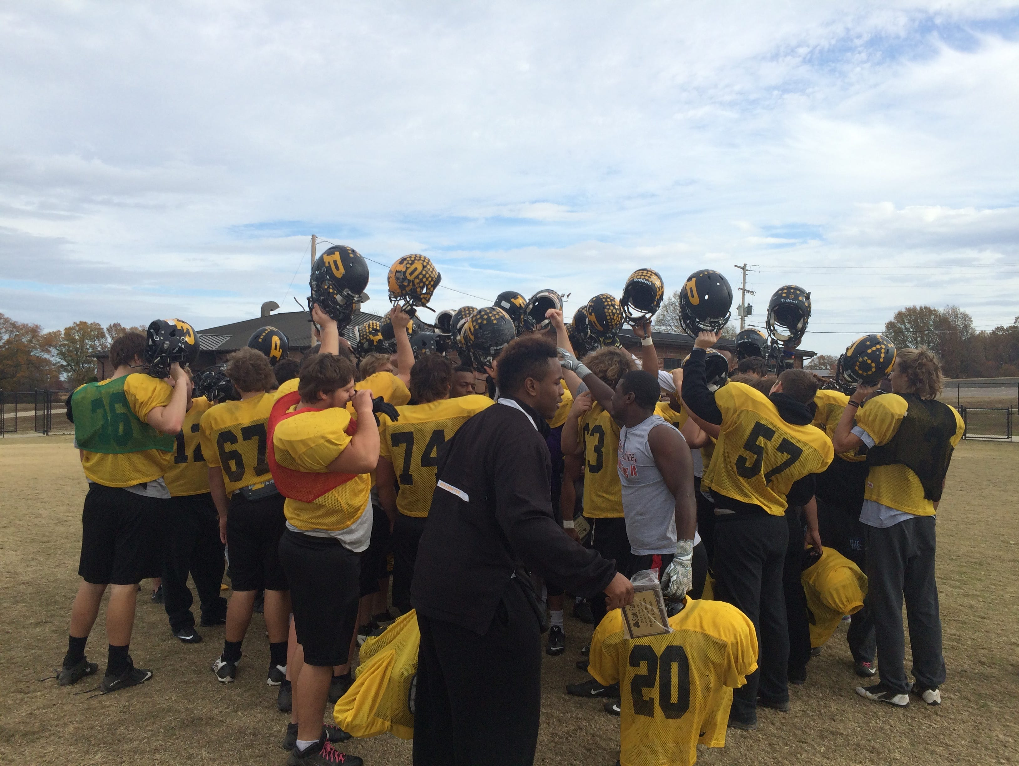 The players from Peabody huddle up at the end of practice Thursday morning.