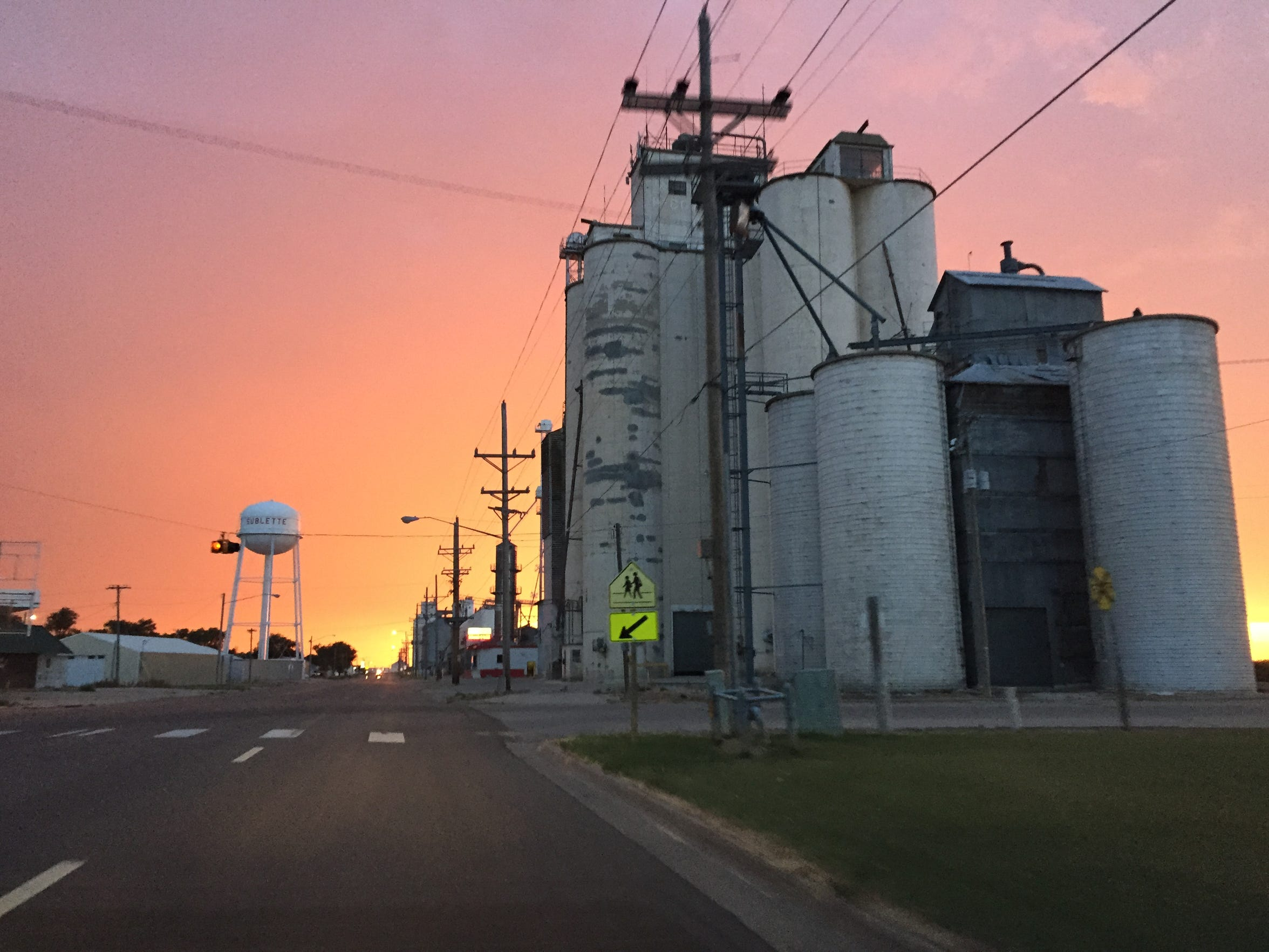 Grain elevators tower over the street in Sublette, Kansas, where the farming economy depends on water pumped from the Ogallala Aquifer.