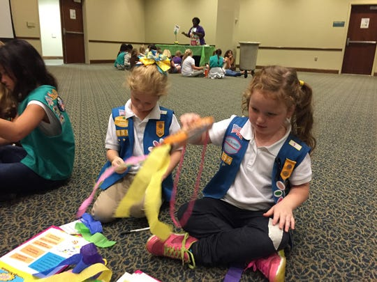 Six-year-olds Abbie McCoy (right) and Amelia Fortunato participate in a craft activity Nov. 21 at a Girl Scouts of Florida Panhandle event in Building 21 of the University of West Florida campus.